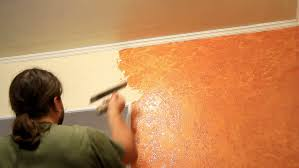 master applies colored wax on ornamental plaster stock footage