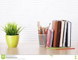 office workplace with supplies and plant stock photo image 72721162