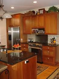 Honey Oak Kitchen Cabinets With Black Countertops  Pearl Or - Kitchen designs with oak cabinets