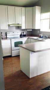 Painting Kitchen Cabinets White Without Sanding by How To Paint Your Kitchen Cabinets Chris Loves Julia