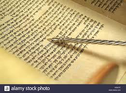 torah yad hebrew torah scroll with silver yad pointing to hebrew script