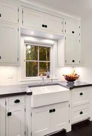 white kitchen cabinets with black hardware dual farmhouse sink traditional kitchen mitch wise design