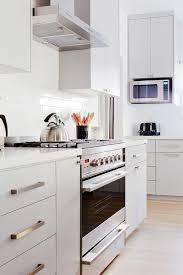 painted white flat panel kitchen cabinets light gray flat front kitchen cabinets modern kitchen
