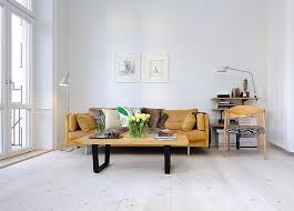 whitewashed wood floors yellow white walls clean meets