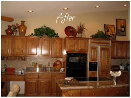 ideas for tops of kitchen cabinets cabinet s top photo 1 kitchen decorating ideas above cabinets
