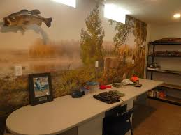 country life tales a fun space is dick s hunting room i found this mural and placed it on the wall like wallpaper he mounted a fish and also a deer in this space