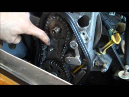 how to check and adjust chain tension snowmobile youtube