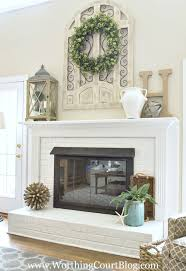 decor the crux grey paint wash on a white brick fireplace with