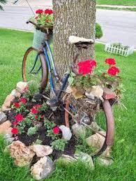 Recycled Garden Art Ideas - watering can garden art ideas jardins et fleur