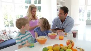 family having breakfast in kitchen together stock video footage