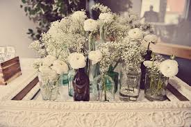 vintage centerpieces wedding reception flowers white centerpieces jars