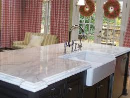 welcoming kitchen designed with glass backsplash and marble