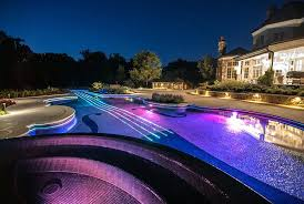 Swimming Pool Ideas For Small Backyards by Pool Designs Ideas Waterfront Pool At Night In Backyard Of Luxury