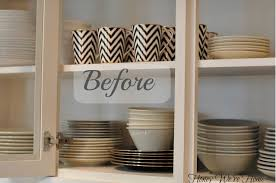 how do you arrange dishes in kitchen cabinets painted kitchen cabinets home design