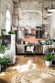 gravity home kitchen with exposed brick in a warehouse apartment