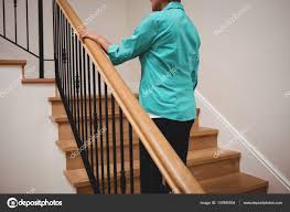 Walking Up Stairs With Crutches by Senior Woman Walking Up Stairs U2014 Stock Photo Wavebreakmedia