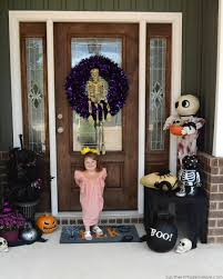 ghoulishly glam halloween decor for the front door southern