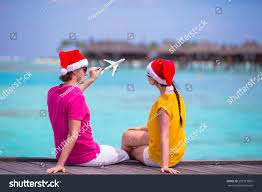 young couple santa hats relaxing on stock photo 283713887