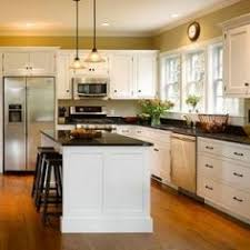shaped kitchen islands l shaped kitchen layout with an arched overhang on the island