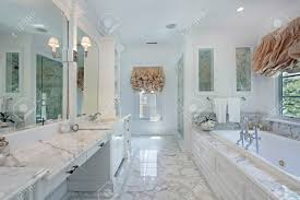 Marble Master Bathroom by Master Bath In Luxury Home With Marble Counters Stock Photo