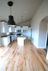 Natural Hickory Laminate Flooring A Saltbox Pretty Floors And Lighting Home Again Pinterest