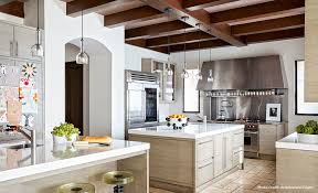 celebrity kitchens with caesarstone both kardashians kitchens complements the ann sacks limestone floor kourtney cook space and adds sleek contrast traditional white