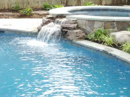 lovely pool design with waterfalls for small backyard home