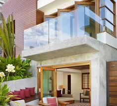 stunning house with a balcony with glass balcony railing home