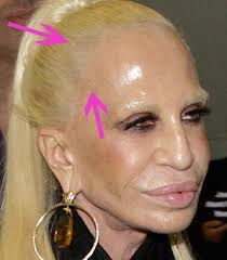 plastic hair 6 things we can t stop staring at in this photo of donatella