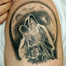 howling wolf with moon on half sleeve