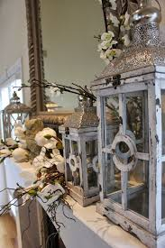white rustic lanterns grouped on a mantel can mix with seasonal