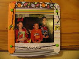 Halloween Picture Frame Made From Craft Sticks And Scrapbook Paper