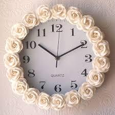 buy a cheap clock glue fabric rosettes around it don u0027t
