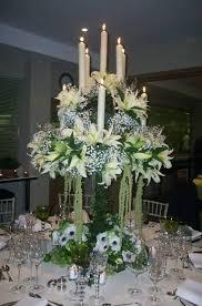 candelieri in ferro battuto candelabri in ferro battuto di varie misure decorati con fiori