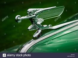 the goddess of speed silver ornament on the of a