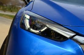 nissan micra headlight bulb some car dealers change light bulbs for free others charge 70