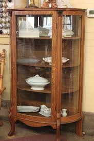antique curio cabinet with curved glass when should you refinish an antique two oak curved glass china