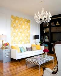 modern living room with yellow walls carpet cushions also paint