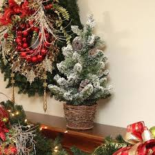 2 u0027 potted flocked pine artificial christmas tree with wicker base