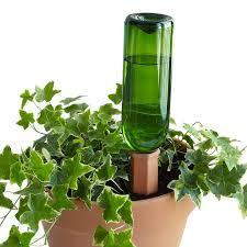 Wine Bottle Planters by 51 Best Self Watering Planters Images On Pinterest Self Watering