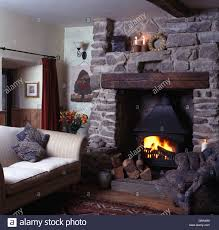 Living Room Ideas Beige Sofa Small Beige Sofa Beside Fireplace With Lighted Wood Burning Stove
