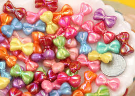 plastic ribbon 18mm ab small bow or ribbon shape iridescent plastic acrylic