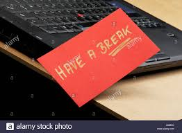 on break sign for desk laptop with sign have a break on a desk stock photo royalty free