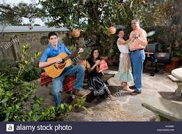 a mexican american family playing music and dancing in the