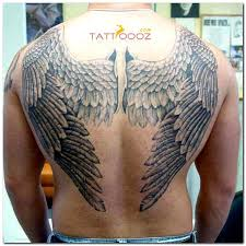 collection of 25 winged cross on lower back