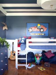 little boy u0027s bedroom red blue and action packed hgtv