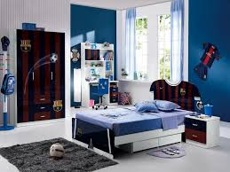 blue wall color boy bedroom ideas using football themes added