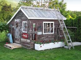 Shed Style Roof by A Tin Roof Tops This Rustic Backyard Shed That Features Distressed