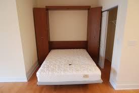 bedroom cozy murphy bed ikea with cozy wood tile flooring for