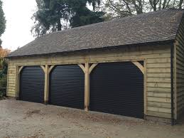 choosing the right garage door design another common design roller garage doors comprise of slim panels that roll up into a cylindrical shape above the entrance to your garage